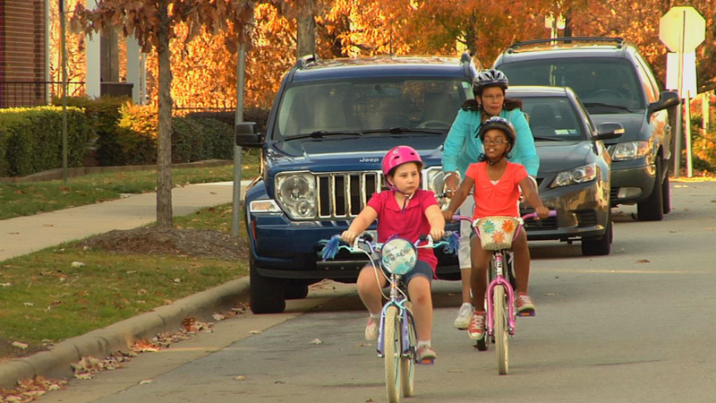 Children and Parent bicycling