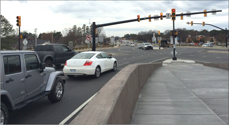 Traffic stopped at a diverging diamond interchange (DDI) in Cornelius, NC. ITRE researchers are developing a national guidebook for engineers and technicians on traffic signal design and operation at DDIs and adjacent intersections.