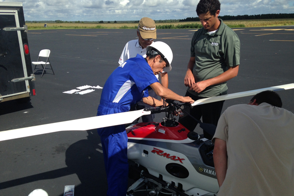 Four men preform a preflight check on a RMAX UAS