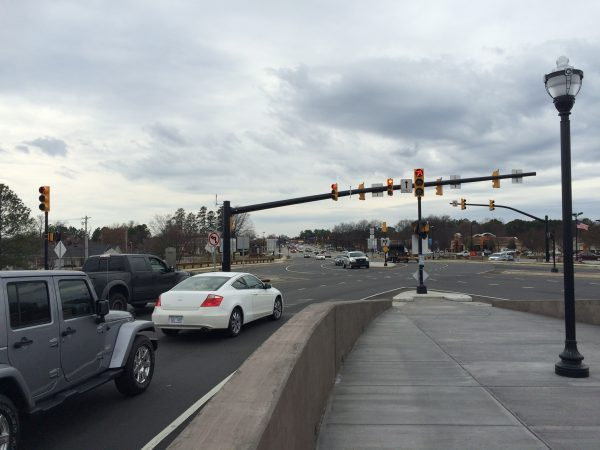 cars stop at the red light of a diverging diamond intersection