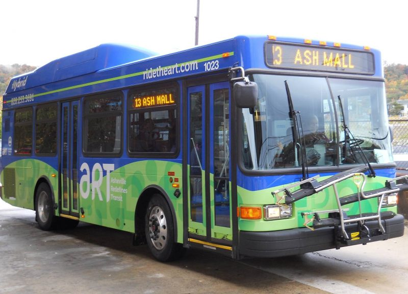 An active ART bus in Asheville shows the 13 Ash Mall stop