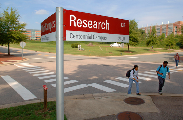 Students make their way across Centennial Campus at the corner of research drive